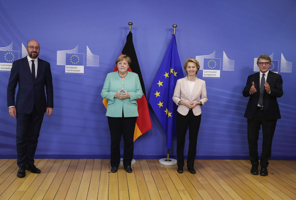 FILE - In this Wednesday, July 8, 2020 file photo, From left, European Council President Charles Michel, German Chancellor Angela Merkel, European Com...