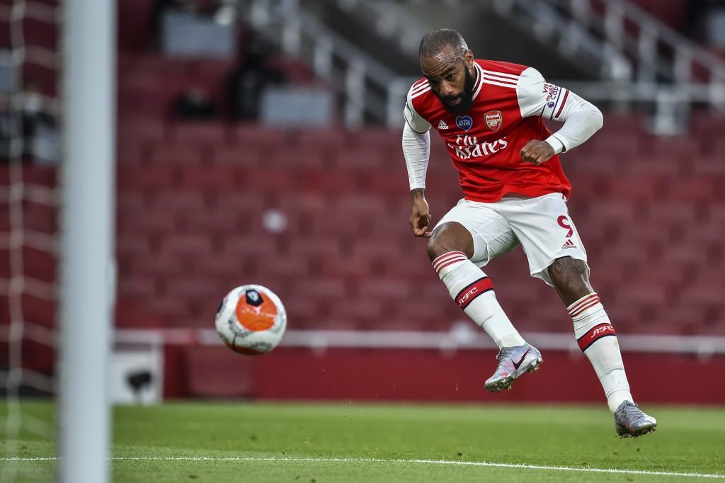 Arsenal's Alexandre Lacazette scores his team first goal during the English Premier League soccer match between Arsenal and Liverpool at the Emirates ...