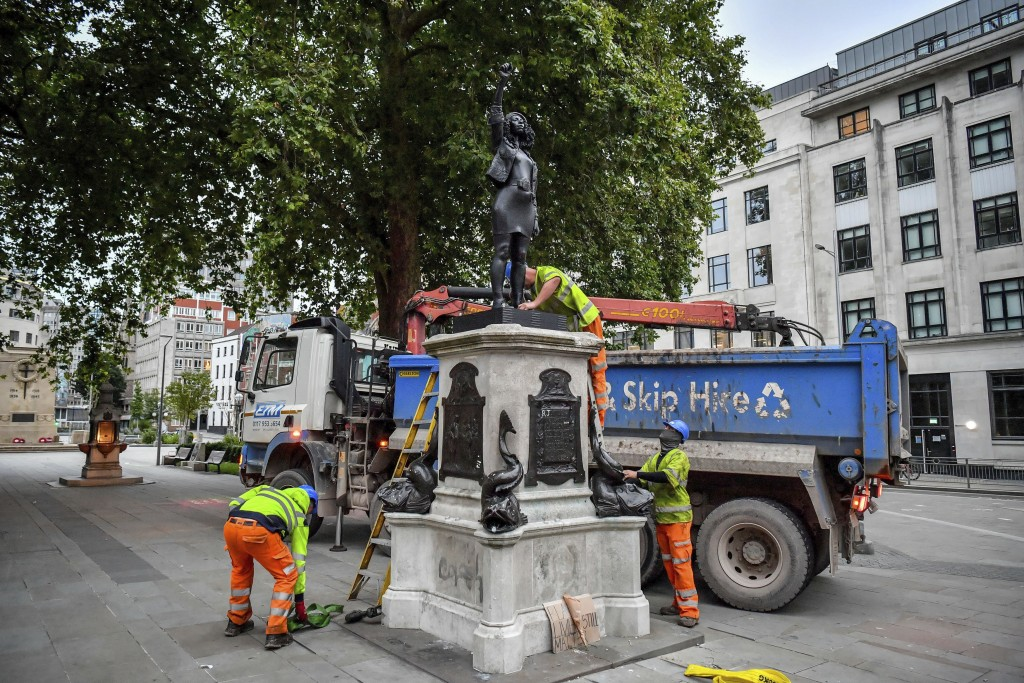 """Contractors prepare to remove the statue """"A Surge of Power (Jen Reid) 2020"""" by artist Marc Quinn, which had been installed on the site of the fallen s..."""