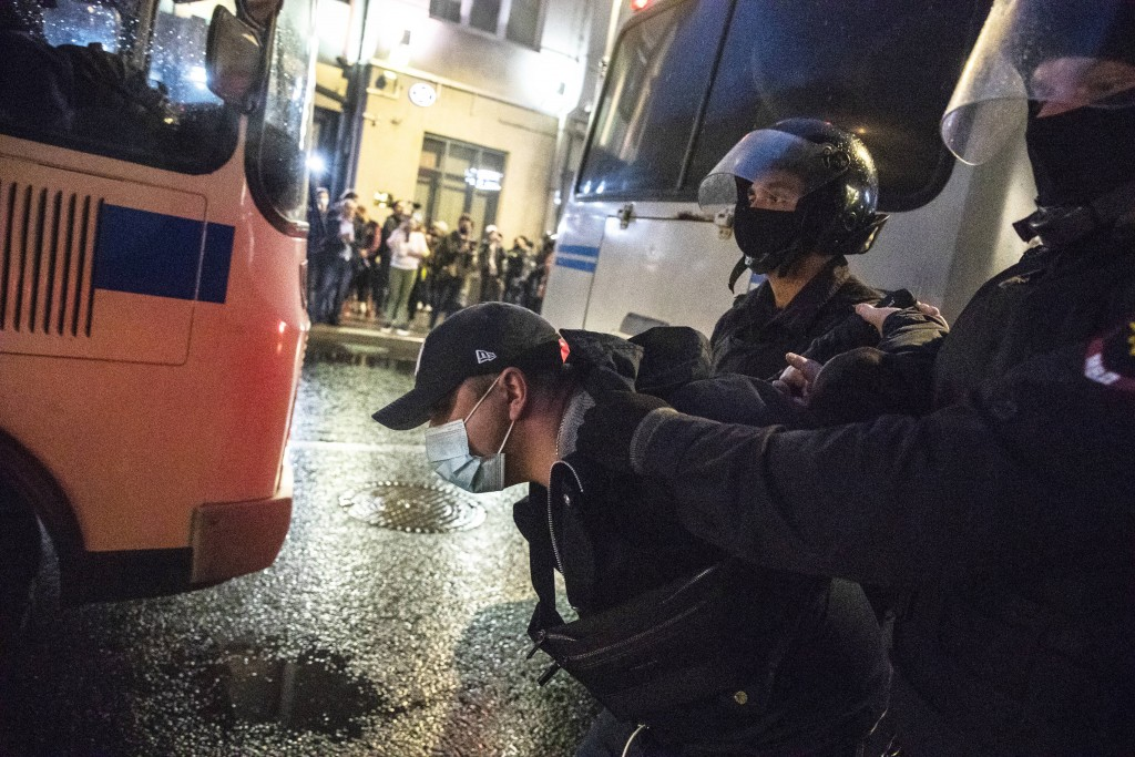 Police officers detain a protester during a rally to cancel the results of voting on amendments to the Constitution in Petrovka street in Moscow, Russ...