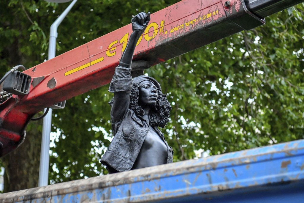 """Contractors remove the statue """"A Surge of Power (Jen Reid) 2020"""" by artist Marc Quinn, which had been installed on the site of the fallen statue of th..."""
