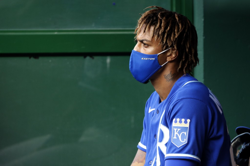 Kansas City Royals' Adalberto Mondesi sits in the dugout during an intrasquad baseball scrimmage at Kauffman Stadium on Wednesday, July 15, 2020, in K...