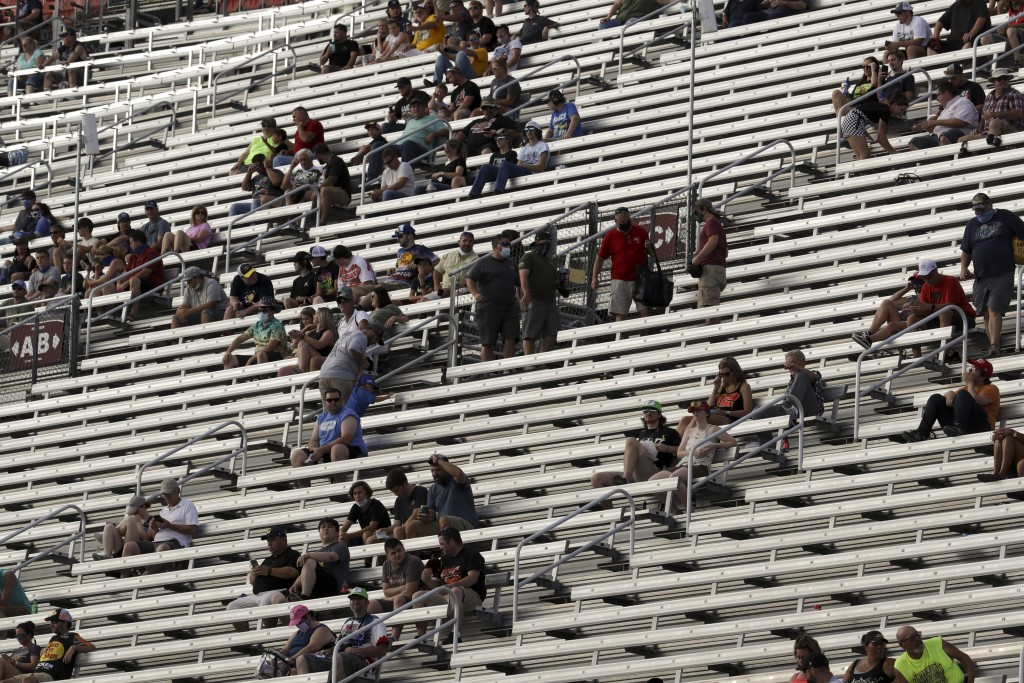Fans wait for the start of a NASCAR All-Star Open auto race at Bristol Motor Speedway in Bristol, Tenn, Wednesday, July 15, 2020. (AP Photo/Mark Humph...