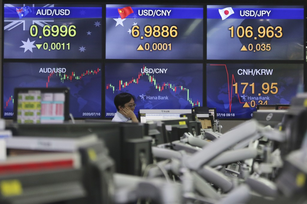 A currency trader watches monitors at the foreign exchange dealing room of the KEB Hana Bank headquarters in Seoul, South Korea, Thursday, July 16, 20...
