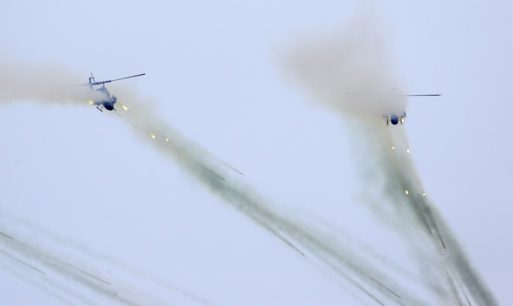 Taiwan's AH-1W attack helicopters launch Hellfire missiles during the 36th Han Kung military exercises in Taichung City, central Taiwan, Thursday, Jul...