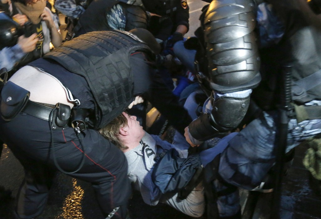 Police detain an activist during a rally in Moscow, Russia, Wednesday, July 15, 2020. Earlier this month a group of opposition activists called for a ...