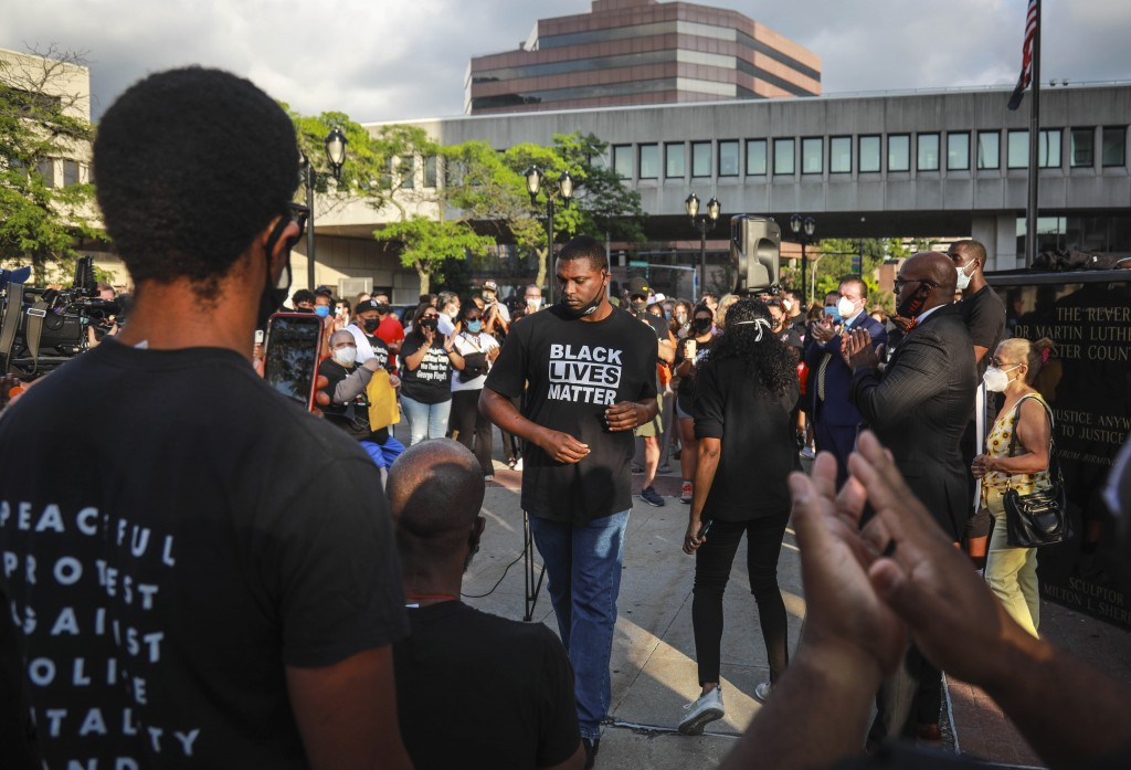 Mondaire Jones, center, winner of the Democratic primary for the 17th Congressional District, is applauded after addressing a Black Lives Matter rally...