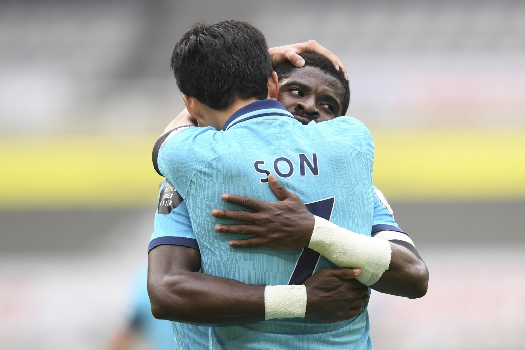 Tottenham's Son Heung-min celebrates with Tottenham's Serge Aurier after scoring his side's opening goal during the English Premier League soccer matc...