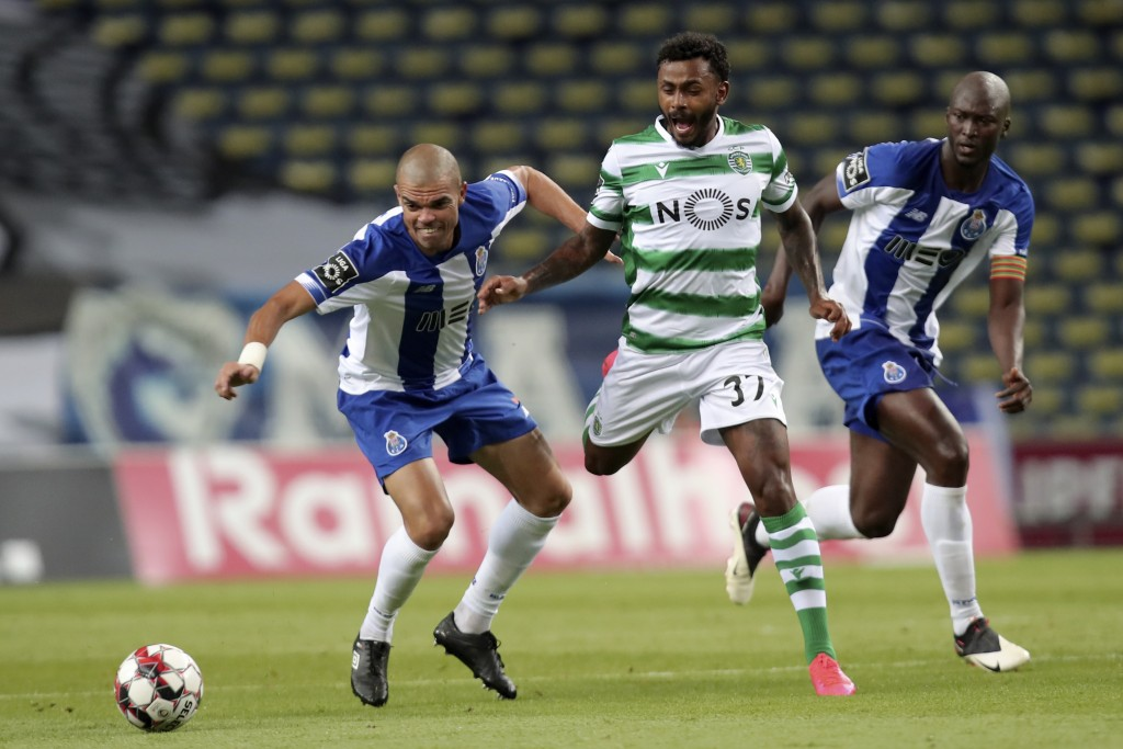 Sporting's Wendel vies for the ball with Porto's Pepe, left, and Danilo Pereira, right, during the Portuguese League soccer match between FC Porto and...