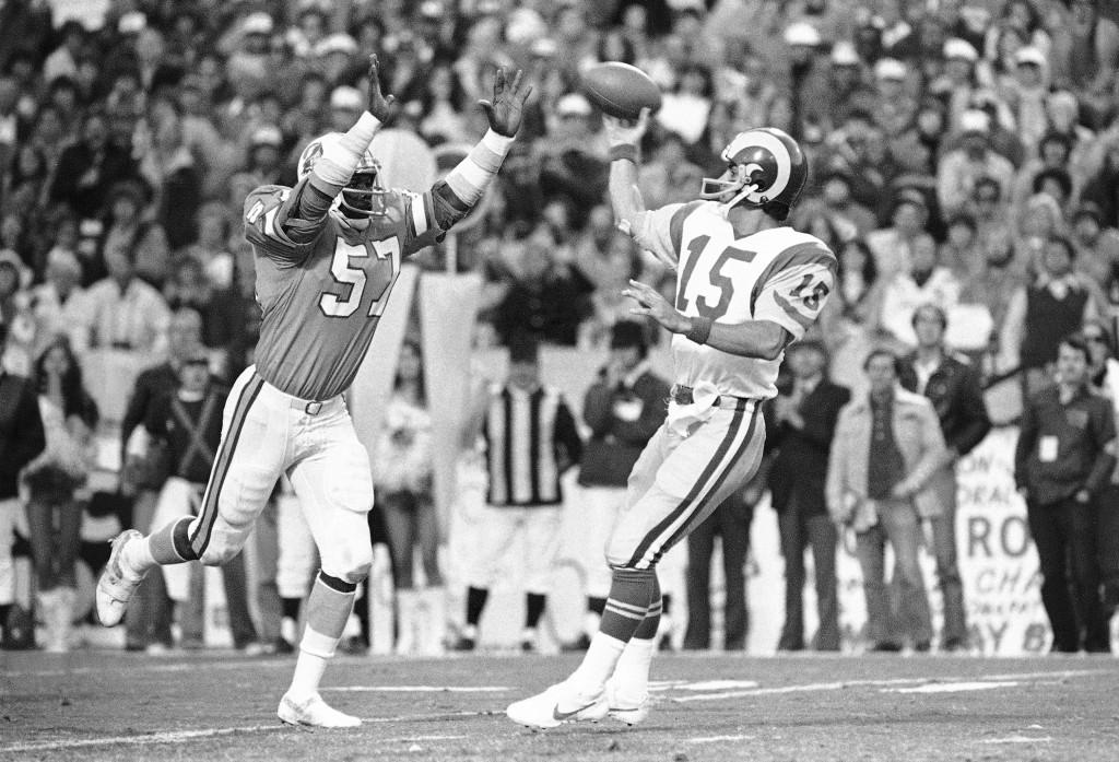 FILE - In this Sunday, Jan. 6, 1980, file photo, Tampa Bay Buccaneers' David Lewis, left, pressures Los Angeles Rams quarterback Vince Ferragamo durin...