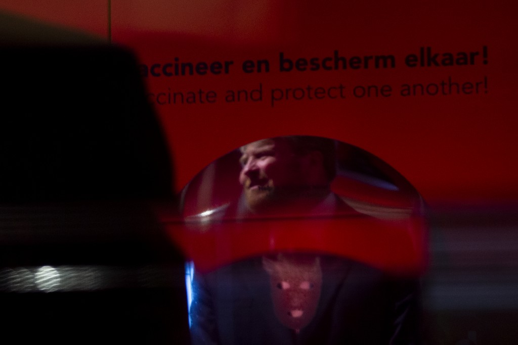 """Dutch King Willem-Alexander is reflected in a mirror as tours the """"Contagious!"""" exhibit at Rijksmuseum Boerhave in Leiden, Netherlands, Thursday, July..."""