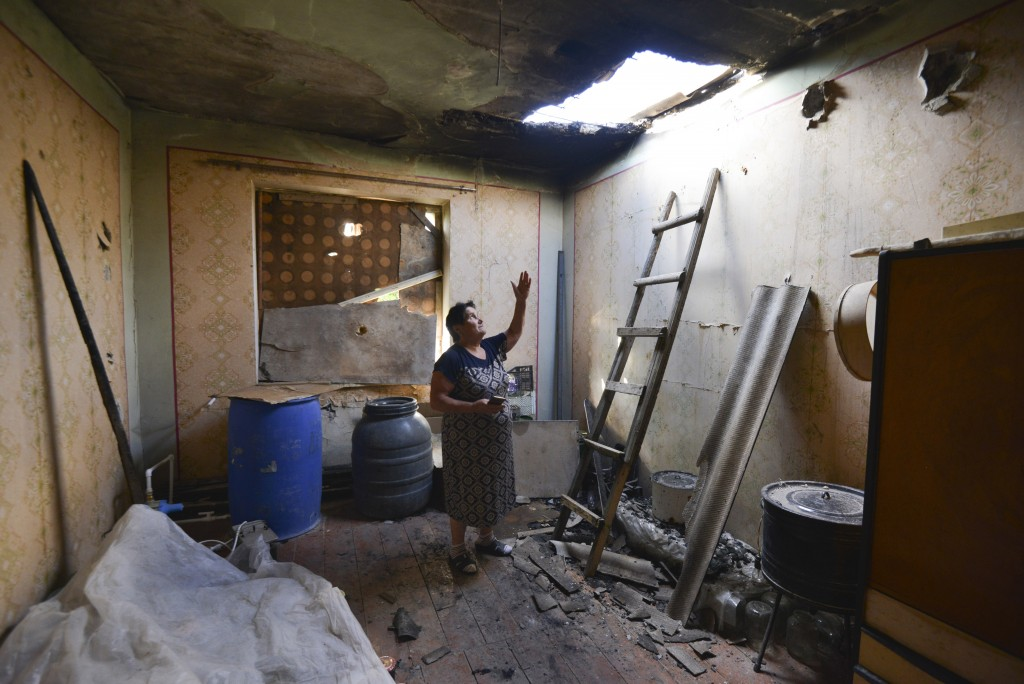 A local woman shows damage in her house after the shelling by the Azerbaijan side in the Aygepar village in Armenia's Tavush region, Armenia, Wednesda...