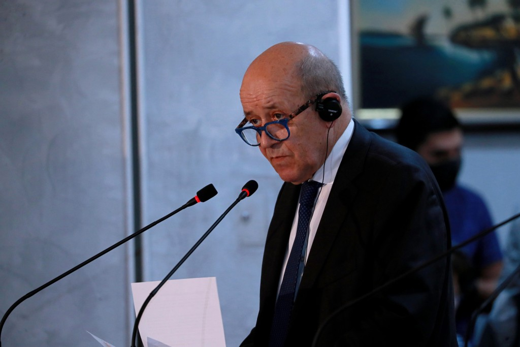 French Foreign Minister Jean-Yves Le Drian attends a news conference with Iraq counterpart Fouad Hussein following their meeting in Baghdad, Iraq, Thu...