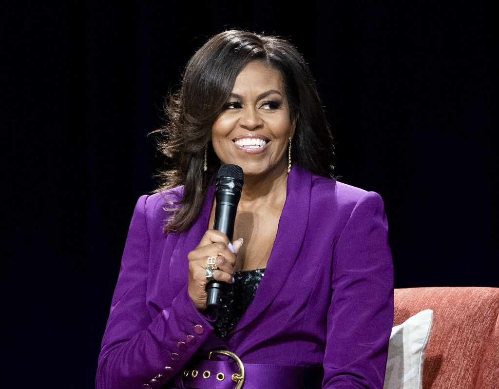 "FILE - This May 11, 2019 file photo shows former first lady Michelle Obama during ""Becoming: An Intimate Conversation with Michelle Obama,"" in Atlanta..."