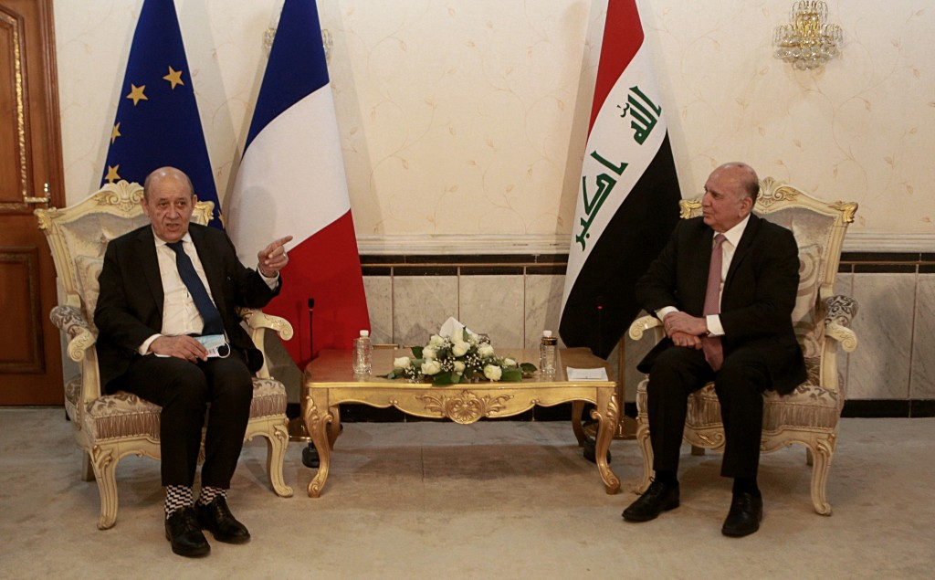Iraqi Foreign Minister Fouad Hussein, right, meets with visiting French counterpart Jean-Yves Le Drian, in Baghdad, Iraq, Thursday, July 16, 2020. (AP...