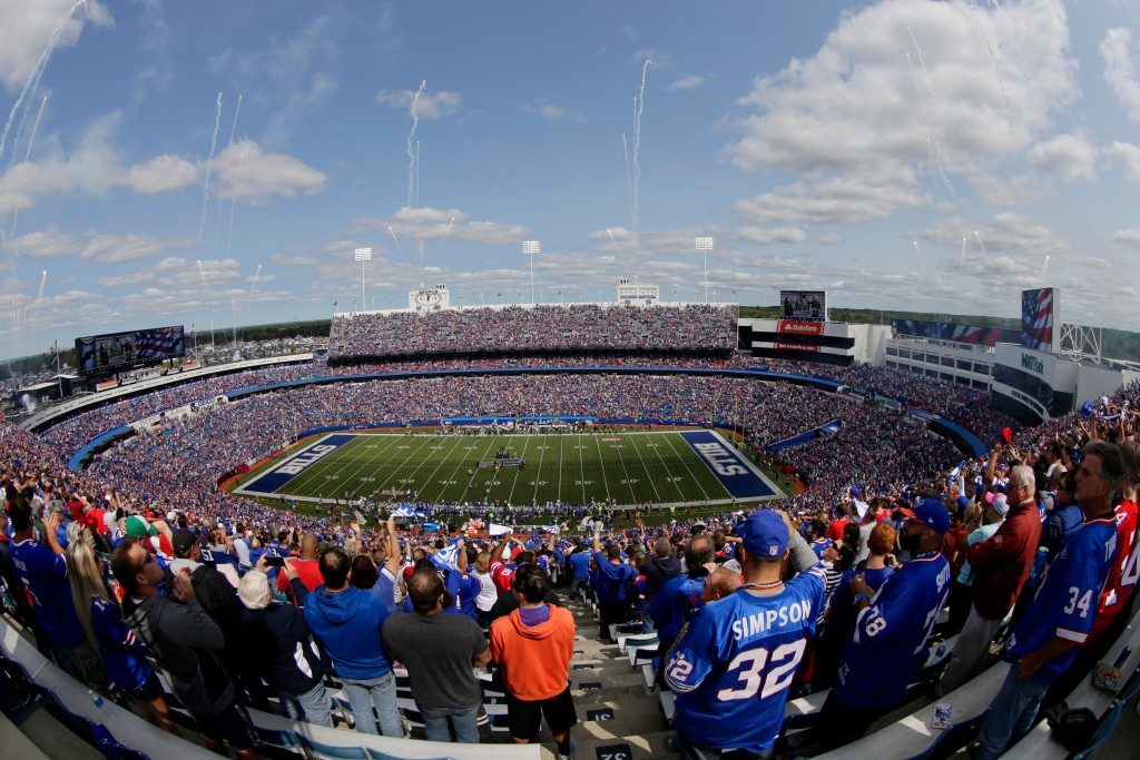 FILE - In this Sept. 10, 2017, file photo, fans stand for the national anthem at New Era Stadium before an NFL football game between the Buffalo Bills...
