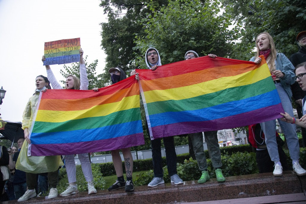 LGBT activists wave their flags during a rally to cancel the results of voting on amendments to the Constitution in Moscow, Russia, Wednesday, July 15...