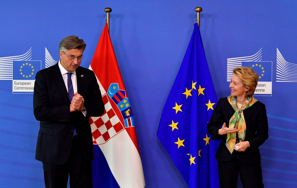 European Commission President Ursula von der Leyen, right, welcomes Croatian Prime Minister Andrej Plenkovic prior to a meeting at EU headquarters in ...