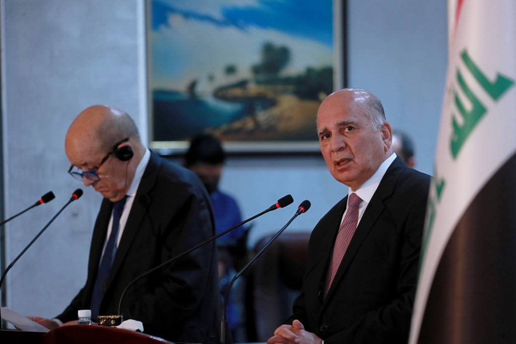 Iraqi Foreign Minister Fouad Hussein, right, and visiting French counterpart Jean-Yves Le Drian, hold a news conference following their meeting in Bag...