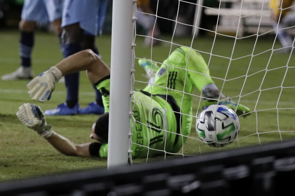 Vancouver Whitecaps goalkeeper Maxime Crepeau is unable to stop a goal by San Jose Earthquakes forward Andres Rios during the first half of an MLS soc...