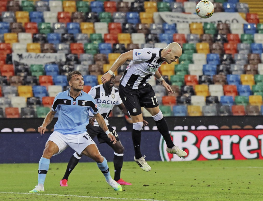 Udinese's Bram Nuytinck, right, in action during a Serie A soccer match between Udinese and Lazio, at the Dacia Arena Stadium in Udine, Italy, Wednesd...