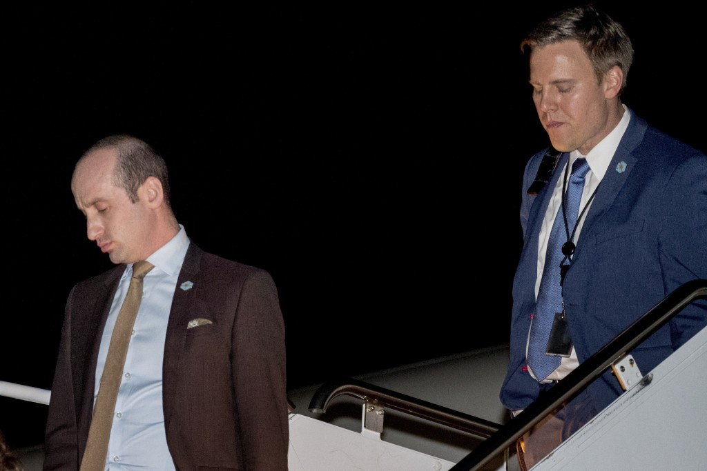 FILE - In this Oct. 13, 2018, file photo President Donald Trump's White House senior adviser Stephen Miller, left, and White House political director ...