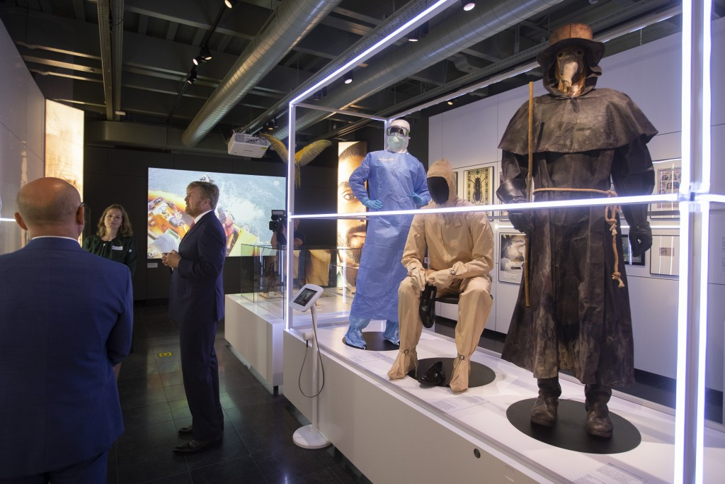 """Dutch King Willem-Alexander, center, curator Mieneke te Hennepe, second left, and director Amito Haarhuis, left, tour the """"Contagious!"""" exhibit at Rij..."""