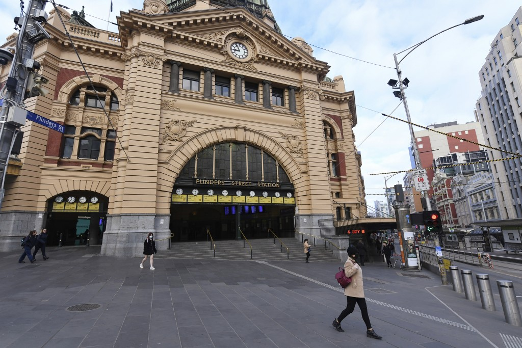 A small amount of people walk outside of Flinders Street Station which would normally be busy with pedestrians during the morning peak hour in Austral...