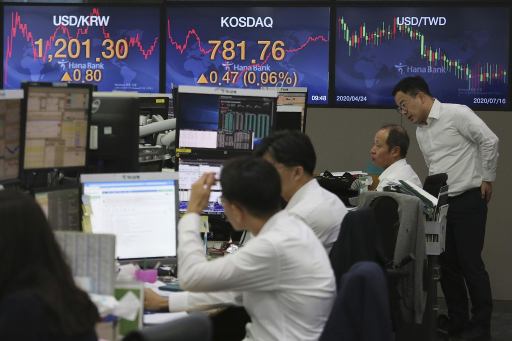 Currency traders watch monitors at the foreign exchange dealing room of the KEB Hana Bank headquarters in Seoul, South Korea, Thursday, July 16, 2020....