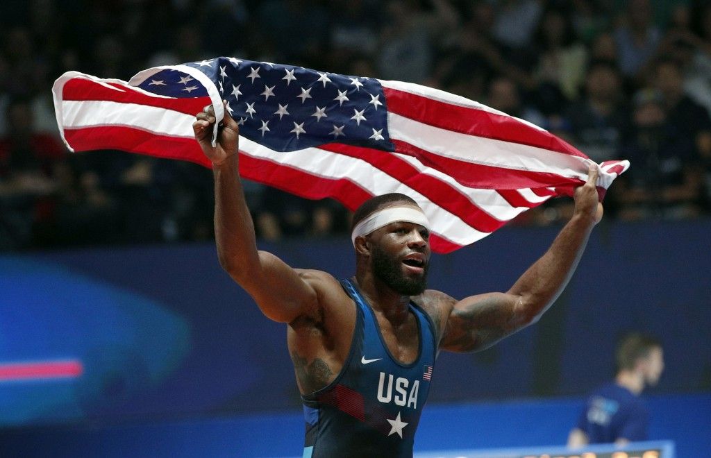 FILE - In this Saturday, Aug. 26, 2017, file photo, United States' Jordan Ernest Burroughs celebrates after defeating Khetik Tsabolov, of Russia, in t...