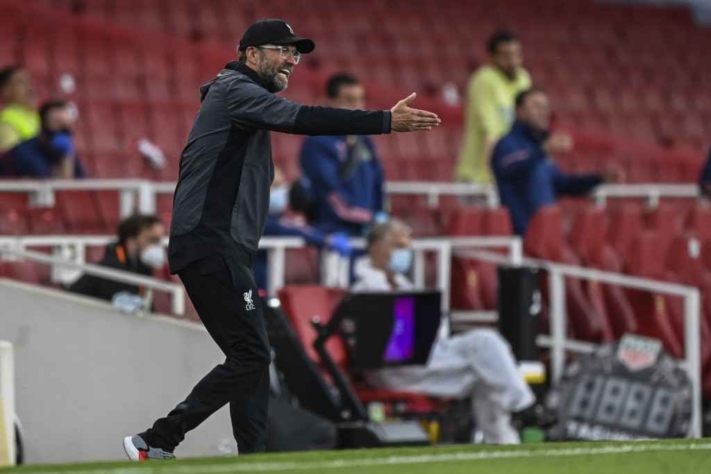 Liverpool's manager Jurgen Klopp gestures during the English Premier League soccer match between Arsenal and Liverpool at the Emirates Stadium in Lond...