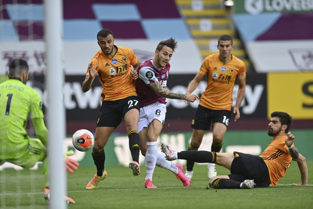 Burnley's Josh Brownhill shoots at goal during the English Premier League soccer match between Burnley and Wolverhampton Wanderers at the Turf Moor st...