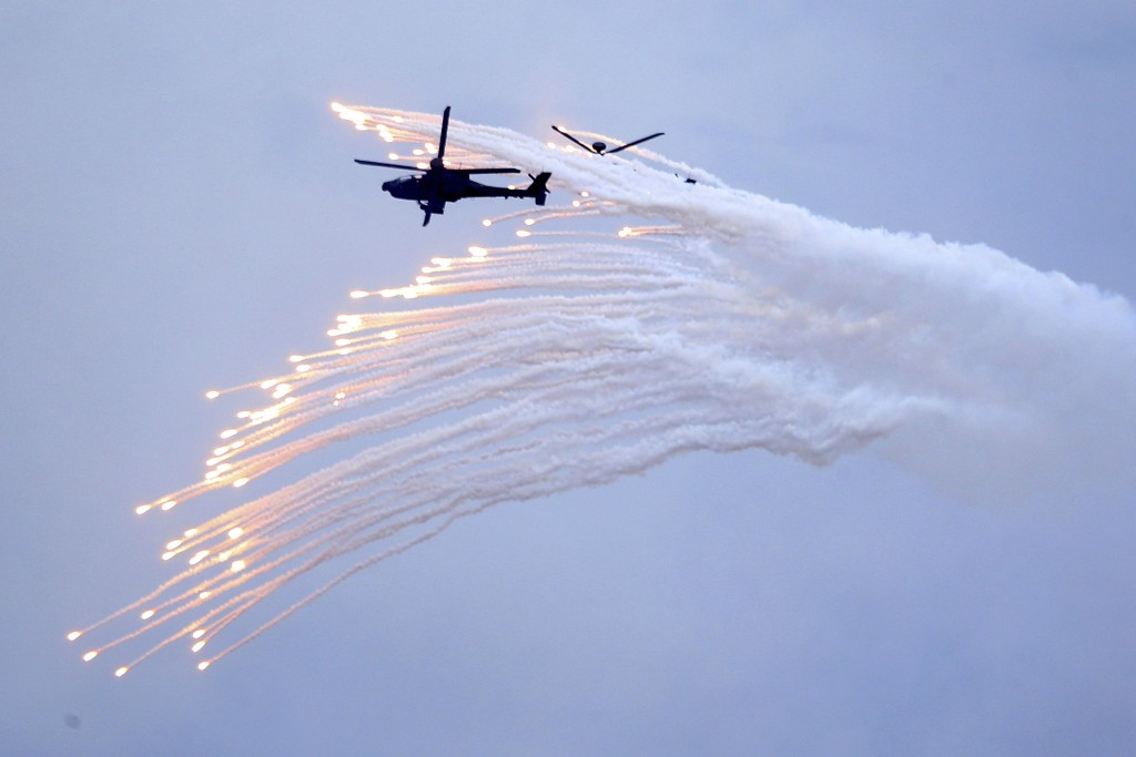Taiwan's AH-64E Apache attack helicopter launches flares during the 36th Han Kung military exercises in Taichung City, central Taiwan, Thursday, July ...