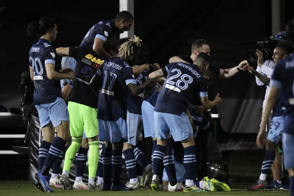 Vancouver Whitecaps players celebrate after forward Cristian Dajome scored a goal during the second half of an MLS soccer match against the San Jose E...