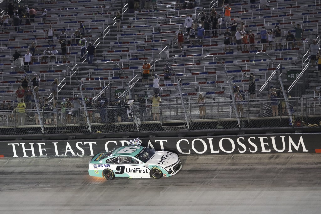Chase Elliott celebrates does a victory lap after winning a NASCAR All-Star auto race at Bristol Motor Speedway in Bristol, Tenn, Wednesday, July 15, ...