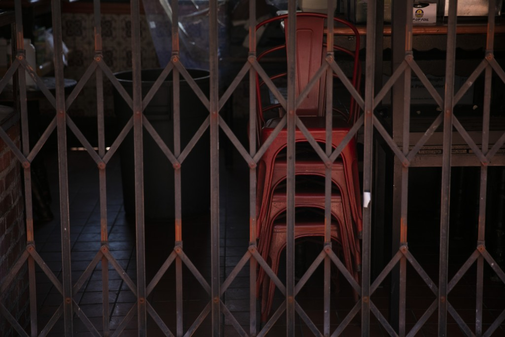 Dining chairs are seen stacked up at a restaurant temporarily closed due to the coronavirus pandemic in Los Angeles, Monday, July 6, 2020. (AP Photo/J...
