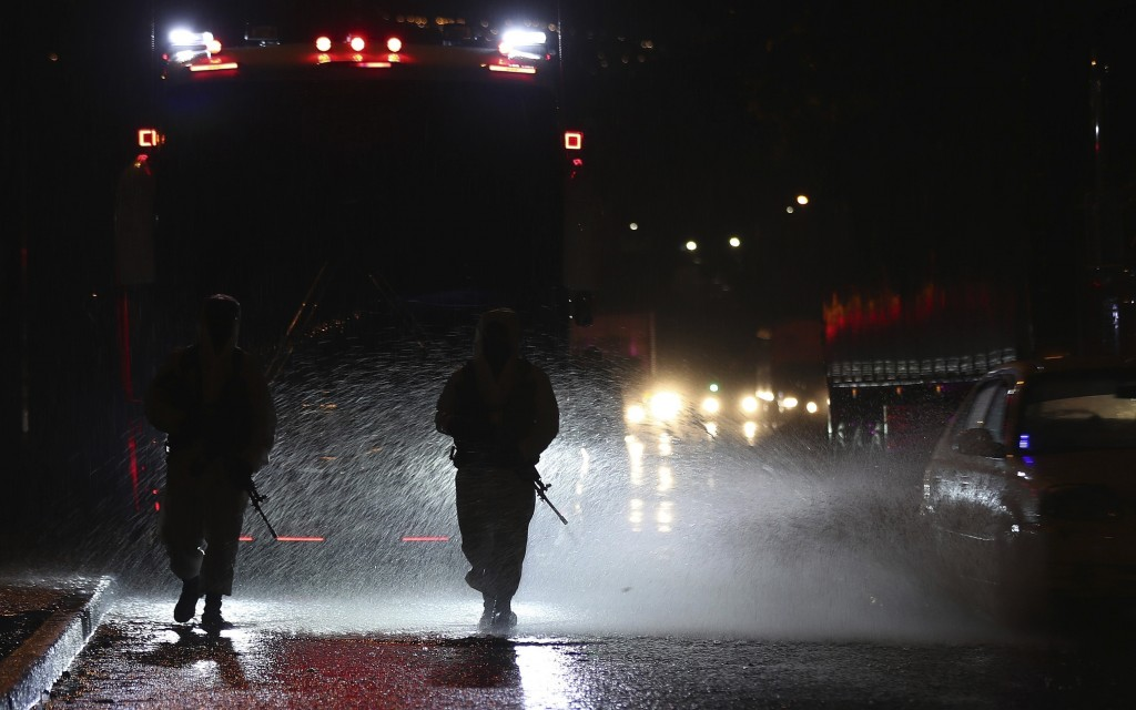 Soldiers in protective gear amid the new coronavirus pandemic patrol the streets of Usme, an area with a high number of COVID-19 cases in Bogota, Colo...