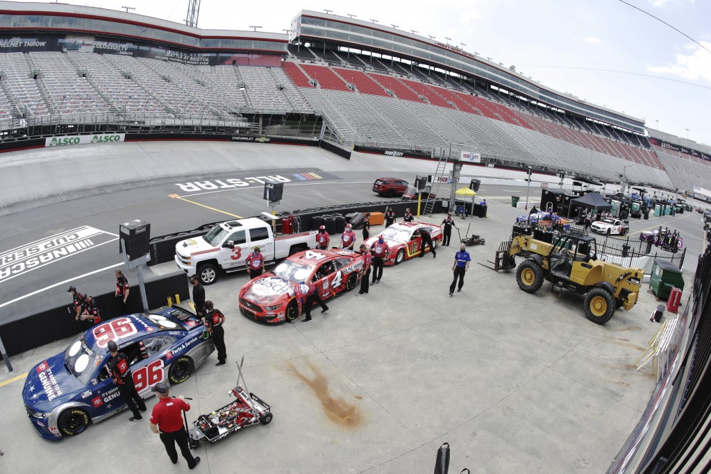 Crews wait to push their cars through the inspection lane before the NASCAR All-Star auto race at Bristol Motor Speedway in Bristol, Tenn, Wednesday, ...