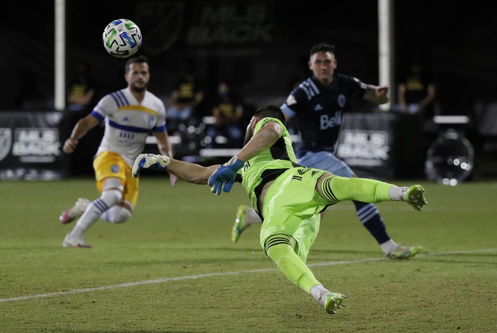 Vancouver Whitecaps goalkeeper Maxime Crepeau blocks a shot during the first half of the team's MLS soccer match against the San Jose Earthquakes, Wed...
