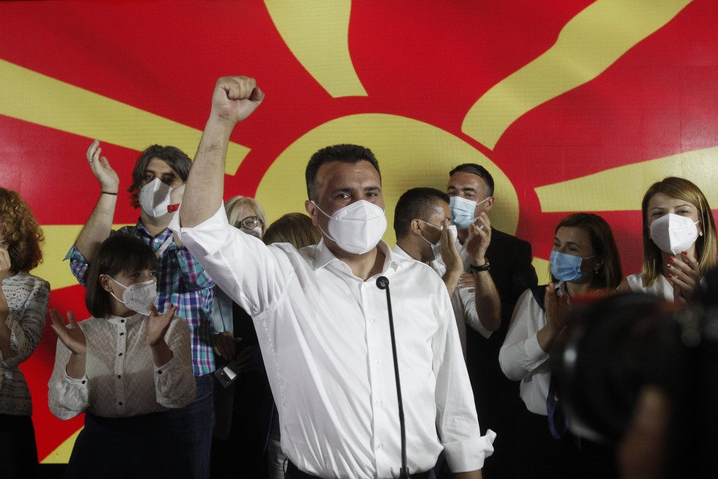 The leader of the ruling SDSM party Zoran Zaev wearing a face mask celebrates his victory at the North Macedonia general election, in Skopje, early Tu...