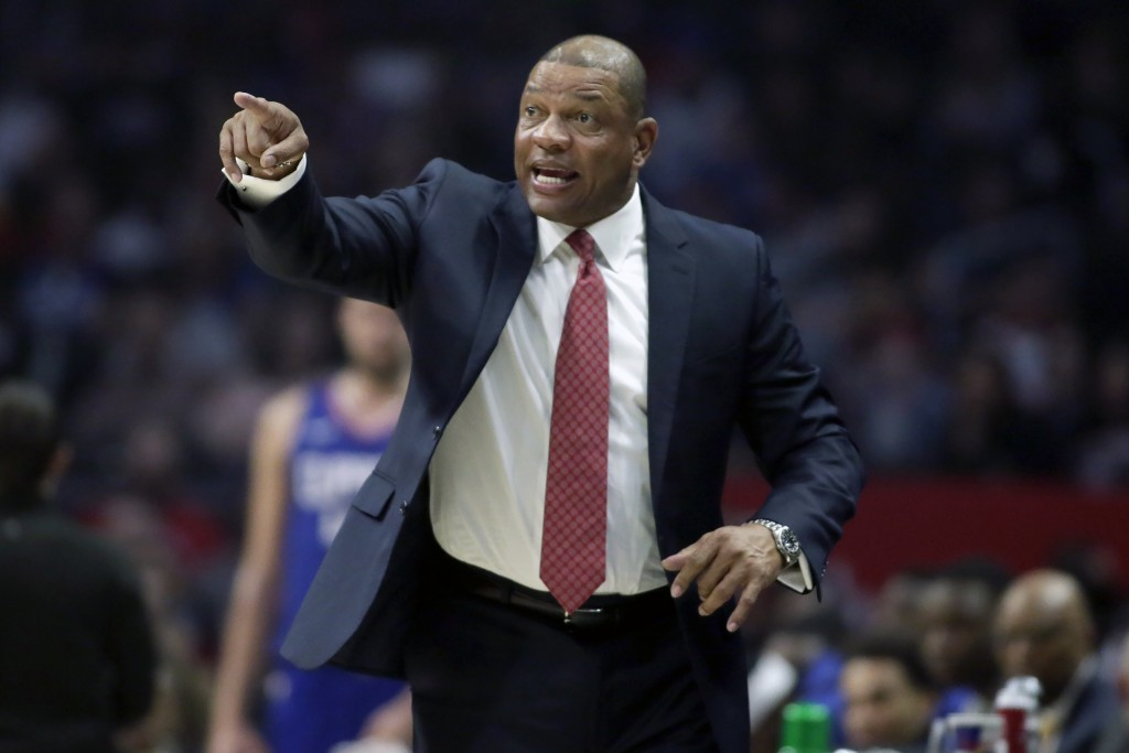 FILE - In this Saturday, Feb. 1, 2020, file photo, Los Angeles Clippers head coach Doc Rivers talks to his players during the first half of an NBA bas...