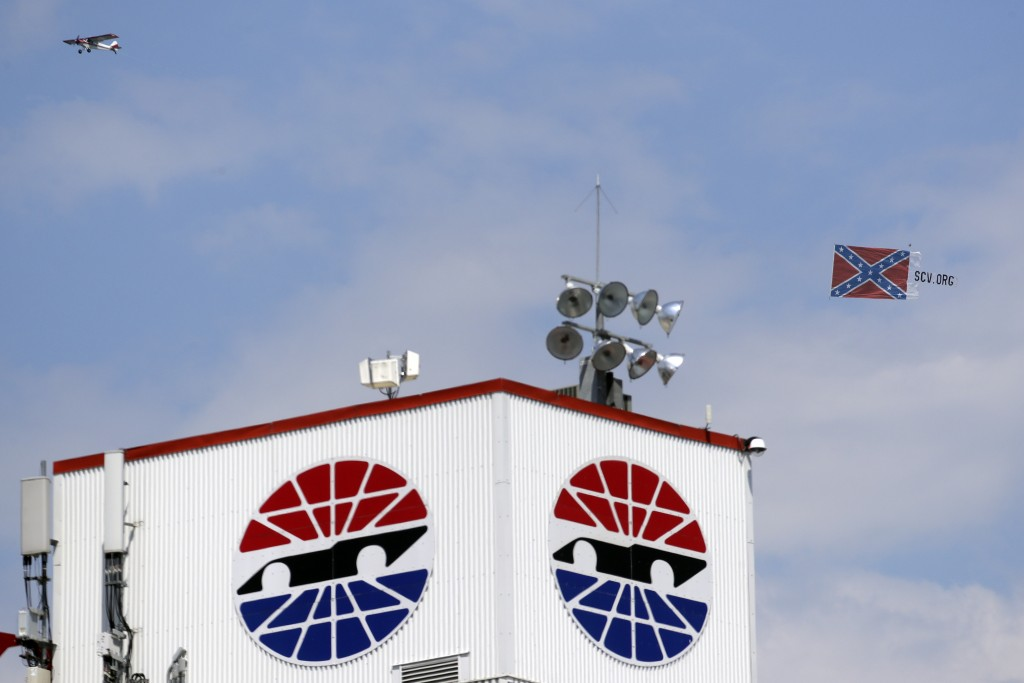 A plane pulls a Confederate battle flag over Bristol Motor Speedway before the NASCAR All-Star auto race in Bristol, Tenn, Wednesday, July 15, 2020. (...