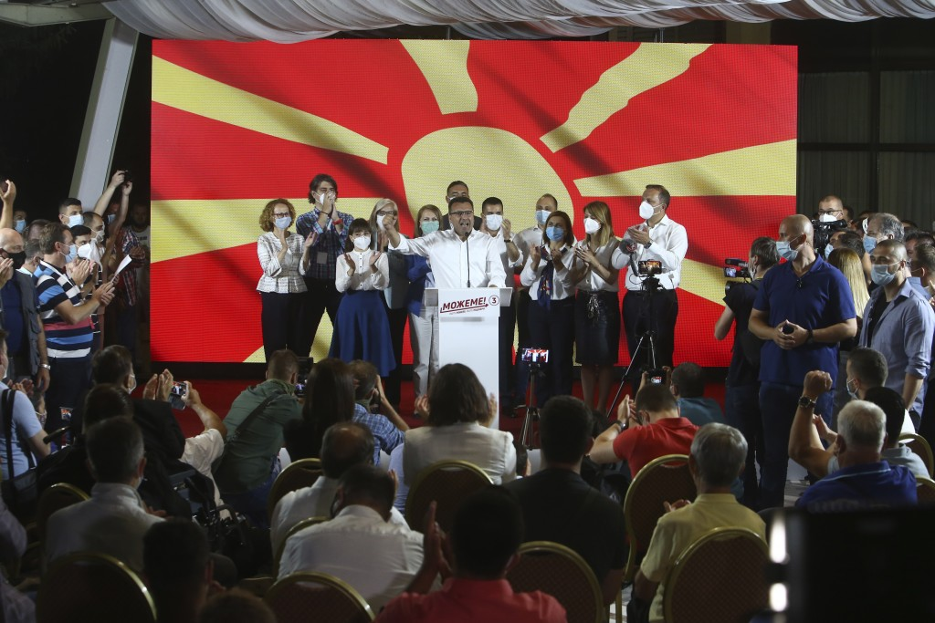 The leader of the ruling SDSM party Zoran Zaev, centre, speaks to supporters and party members after his victory at the North Macedonia general electi...