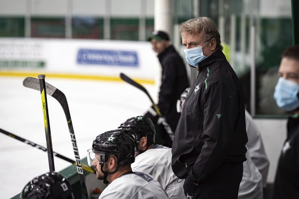 In this photo provided by the Dallas Stars NHL hockey team, interim head coach Rick Bowness watches practice in Frisco, Texas, Tuesday, July 14, 2020....
