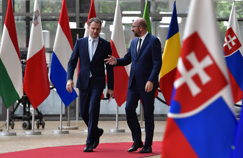 European Council President Charles Michel, right, welcomes Slovakia's Prime Minister Igor Matovic prior to a meeting at the European Council building ...