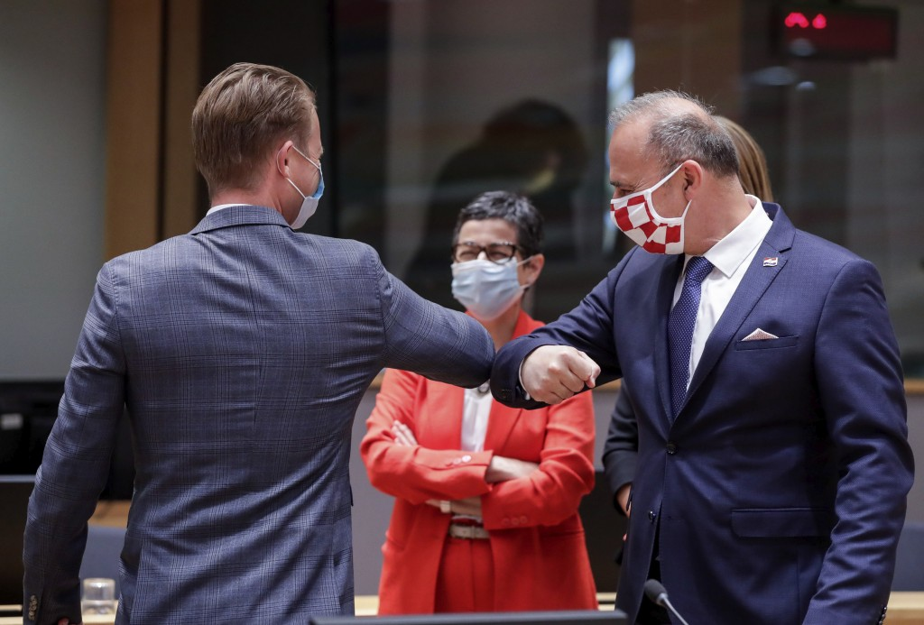 FILE - In this Monday, July 13, 2020 file photo, Denmark's Foreign Minister Jeppe Kofod, left, and Croatia's Foreign Minister Gordan Grlic Radman, rig...