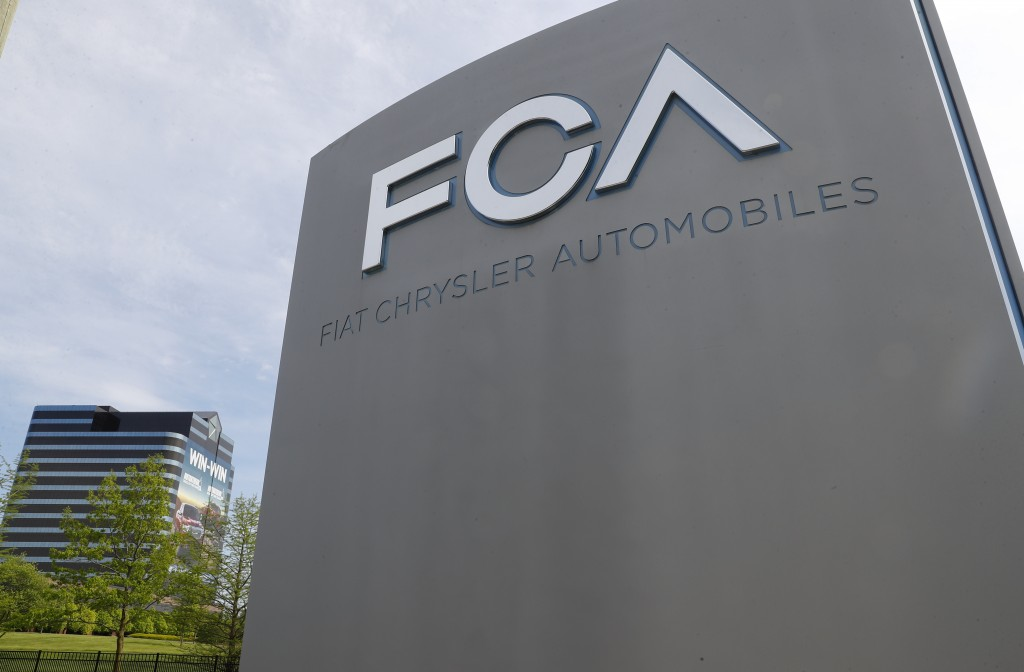 FILE - In this May 27, 2019, file photo, the Fiat Chrysler Automobiles world headquarters is shown in Auburn Hills, Mich. When Italian-American automa...