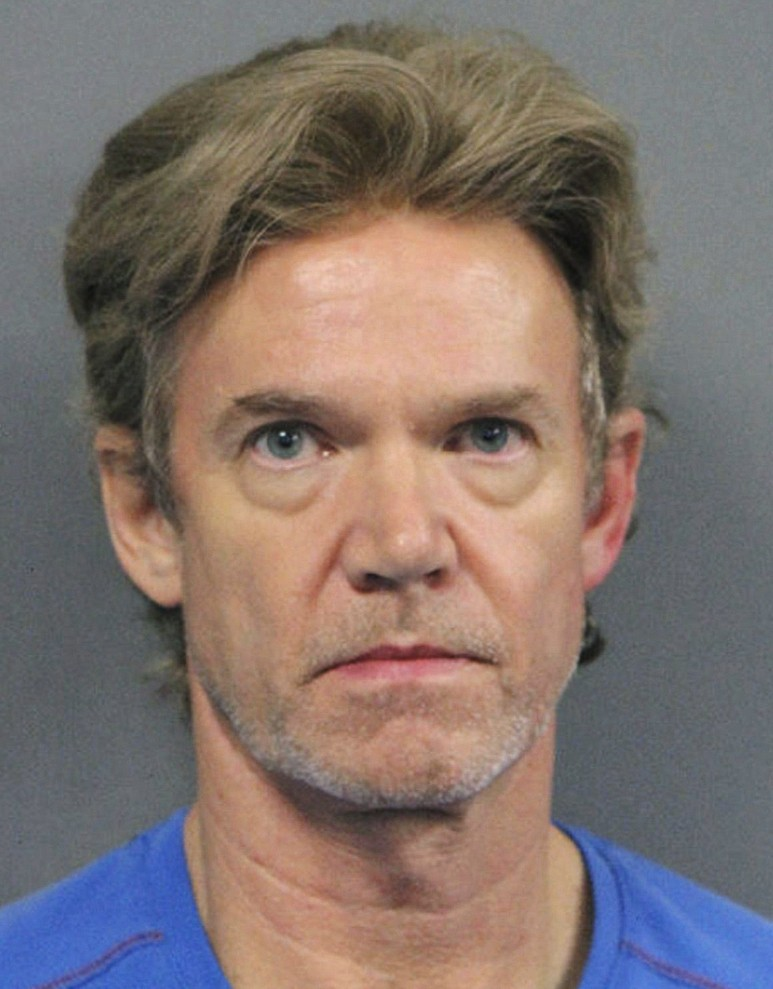 FILE - This undated file photo released by the Jefferson Parish Sheriff's Office shows Ronald Gasser, accused of killing former NFL running back Joe M...