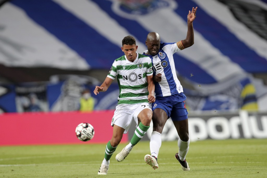 Porto's Danilo Pereira fights for the ball with Sporting's Matheus Nunes, left, during the Portuguese League soccer match between FC Porto and Sportin...