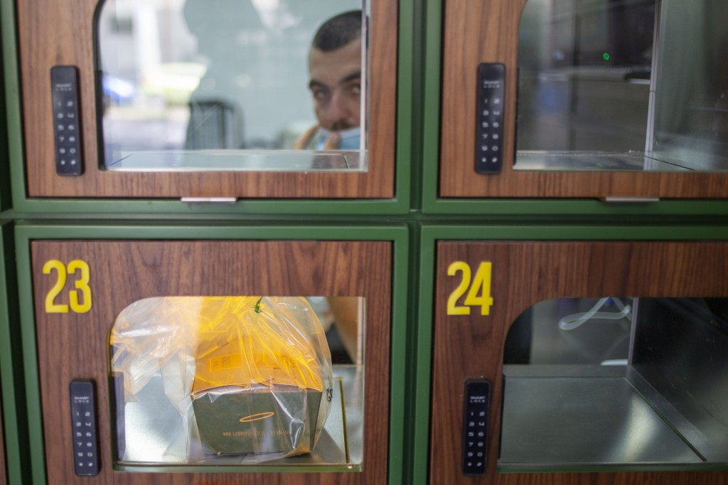 A ready to take away Go Noodles box is placed in a glass-paned locker in Tel Aviv, Israel, Thursday, July 16, 2020. The coronavirus crisis and its eco...